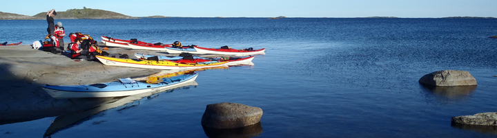 Aland Islands kayakers take an evening break