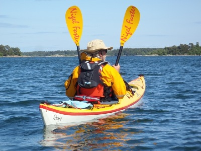 Sweetwater KAyaks Russell Farrow using his Nigel Foster Air paddles as sails in his Whisky18 kayak